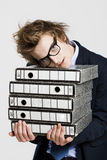 Business man carrying folders Royalty Free Stock Photo