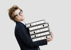Business man carrying folders Royalty Free Stock Photography