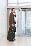 Business man carrying luggage Stock Photos