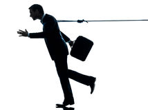 Business man catched by lasso rope silhouette Royalty Free Stock Images