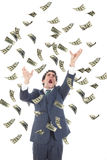 Business man catching falling dollars banknotes and screaming. Angry stressed man grabbing flying money Stock Photography