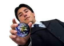 Business man catching the world Stock Photography