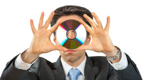 Business Man with CD. Business Man is holding a data CD in front of his head. With white background Stock Photo