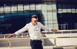 Business man celebrates freedom success arms. Royalty Free Stock Images