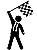 Business man celebrates victory checkered flag Royalty Free Stock Photography