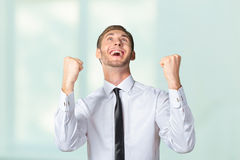 Business man celebrating with arms up Royalty Free Stock Image