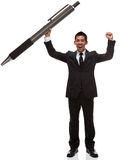 Business man celebrating holding a huge pen Stock Image