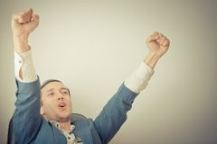 Business man celebrating with two arm up Stock Photo