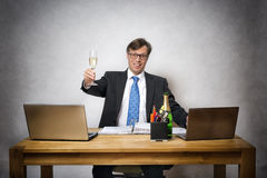 Business man with champagne glass Royalty Free Stock Photography