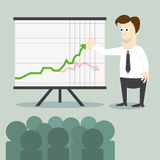 Business man with chart presentation to people Stock Images