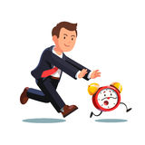 Business man chasing deadline time in a rush hour. Late business man chasing deadline time in a rush hour. Businessman running after animated alive clock. Flat Royalty Free Stock Image