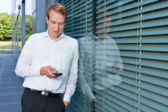 Business man chatting with smartphone Royalty Free Stock Photos