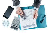 Business man checking a financial report Royalty Free Stock Image