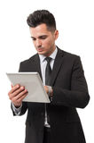Business man checking tablet for stock market news Royalty Free Stock Image