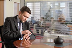 business man is checking time stock photo