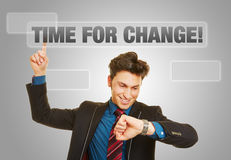 Business man checking time for change. On his watch Stock Image