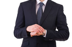 Businessman checking time on his wristwatch. Stock Images