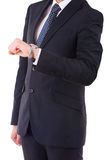 Businessman checking time on his wristwatch. Royalty Free Stock Photo