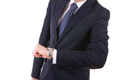 Businessman checking time on his wristwatch. Stock Photography