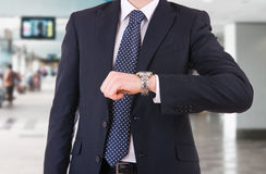 Businessman checking time on his wristwatch. Royalty Free Stock Photos
