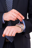 Businessman checking time on his wristwatch. Stock Photos