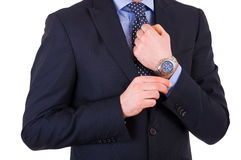 Businessman checking time on his wristwatch. Royalty Free Stock Images