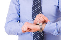 Businessman checking time on his wristwatch. Stock Photo
