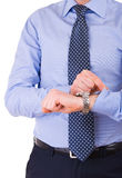 Businessman checking time on his wristwatch. Royalty Free Stock Photography