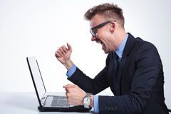 Business man cheers at laptop Royalty Free Stock Image