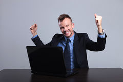 Business man cheers at laptop Royalty Free Stock Photo