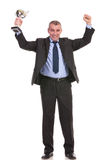 Business man cheers and looks at you Royalty Free Stock Photos