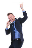 Business man cheers while on phone Royalty Free Stock Photos