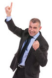 Business man cheers while pointing upward Stock Photos