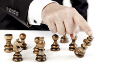 Business man and chess figures Royalty Free Stock Images