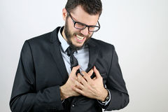 Business man with chest pain. Due to heart attack royalty free stock photo