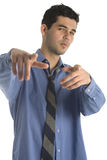 Business Man Chilling. A 20 year old latino business man isolated on a white background stock image
