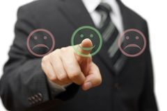 Business man choose  smile icon  and not the sad one Stock Photos