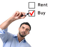 Business man choosing rent or buy option at formular real estate concept