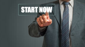 Business Man Choosing Start Now Stock Photos