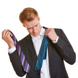 Business man choosing a tie Royalty Free Stock Photos