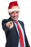 Business man in  christmas hat pointing finger Royalty Free Stock Photography