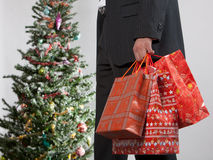 Business man with christmas presents Royalty Free Stock Photography