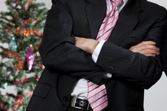 Business man by christmas tree Royalty Free Stock Images