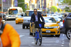 Business Man on a Citibike in New York City Stock Photography