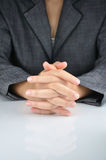 A business man with an clasp hand to contemplate Royalty Free Stock Image