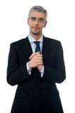 Business man with clasped hands. Confident businessman holding his hands clasped Stock Photo