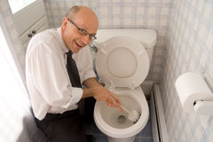 Business Man cleaning toilet Royalty Free Stock Images