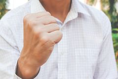 Business man with clenched fist, Encourage Great fight, Business man actions empower. A Business man with clenched fist, Encourage Great fight, Business man royalty free stock photo
