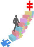 Business man climb up puzzle steps Royalty Free Stock Photos