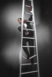 Business man climbing broken ladder_3 Stock Image